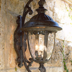 """""""Park Lane"""" Lantern - Illuminate your porch or patio with the """"Park Lane"""" Lantern.  This outdoor lantern is crafted of aluminum with a burnished rust finish and water glass to give it an old world feel."""