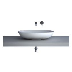 Maestrobath - Teknoform Gamma Modern White Bathroom Sink - With its rectangular shape slightly curved along the length and width, smooth edges and a shallow but open interior, this contemporary bathroom sink is masterfully created to possess a low profile for your modern counter top design. Made out of TeknoForm, a durable polymer-based material, the A.D.A compliant vessel sink is available in a clean white color, and the luxury bathroom sink will fit into your space elegantly and seamlessly.