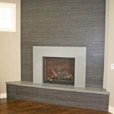 Modern Indoor Fireplaces by Concrete Arts
