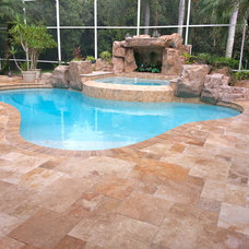 Beach Style Swimming Pools And Spas by RockImport.com