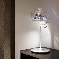 Gloss Acrylic Shade Table Lamp - Adding dynamic movement to the original form, this hybrid design allows you to send two separate lamp shades in different directions independently of each other. Gloss' halogen lamps are clearly visible through the transparent acrylic shades. This lamp is available in clear, orange, bronze and blue colors.