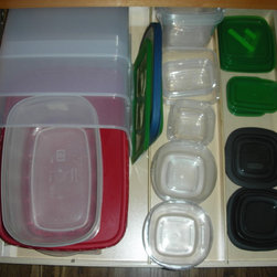 Kitchen Pull Out Shelves - Better storage for your storage containers -- pull out shelves from ShelfGenie of Los Angeles.  Add shelf dividers to create separate compartments for the containers and the lids and end the hunting around for your lids.