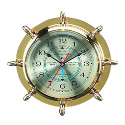 """Brass Ship's Wheel Quartz Tide & Time Clock - The brass ship's wheel quartz tide  time clock measures 9.5""""Dia x 2""""D. This quartz ship's wheel tide  time clock comes in a solid brass tarnish proof case with beveled glass. This beautiful instrument will accurately predict the tide cycles in your area  show time. It will add a definite nautical touch to whatever room it is placed in and is a must have for those who appreciate high quality nautical decor. It makes a great gift, impressive decoration  will be admired by all those who love the sea."""