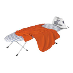 Honey Can Do - Honey Can Do Folding Table Top/Counter Top Ironing Board Multicolor - BRD-01292 - Shop for Ironing Boards from Hayneedle.com! Iron out the wrinkles in your wardrobe at home or on the road with the Honey Can Do Folding Table Top/Counter Top Ironing Board. Crafted with a durable metal rest and a 100% cotton blue striped cover this tabletop ironing board folds in half for compact storage in closets or a suitcase. A thick fiber pad beneath the cover ensures smooth ironing every time.About Honey-Can-DoHeadquartered in Chicago Honey-Can-Do is dedicated to helping you organize your life. They understand that you need storage solutions that are stylish and affordable at the same time. Honey-Can-Do focuses on current design trends and colors to create products that fit your decor tastes while simultaneously concentrating on exceptional quality. When buying a Honey-Can-Do product you can be sure you are purchasing a piece that has met safety control standards and social compliance methods.
