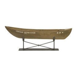 Vintage River Canoe on Metal Stand - The hand carved vintage river canoe is raised on a metal stand and brings back memories of summer camp. Looks great in a variety of interiors!