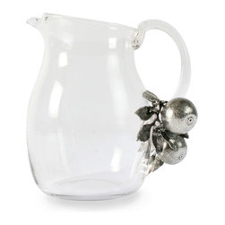 Orange Blooms Glass Pitcher - A queenly corsage of fruit and flowers adorns the base of the Orange Blooms Glass Pitcher's handle, an unexpected and abundant pewter embellishment that adds complexity and grace to the simple silhouette of this clear glass vessel.  Suggesting itself as ideal for breakfast, it's also wonderful for iced tea and for pre-mixed cocktails like sangria.