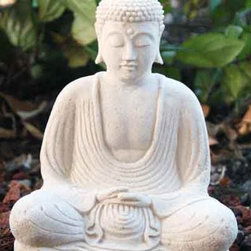 White Stone Buddha Statue - Religious relics are so beautiful and are a great way to incorporate a bit of ethnic inspiration into your home. I have one in my bathroom that I look at every day as I'm getting ready. They are so peaceful outdoors in a garden setting as well.