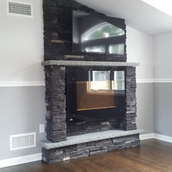 Clifton, NJ Traditional Style Addition - Electric Fireplace. Fireplace surround done in master bedroom. Made using cultured stone and blue stone.