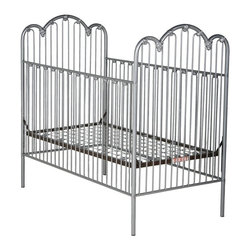 Corsican - Corsican Scalloped Iron Crib with Flowers - 43594-101 - Shop for Cribs from Hayneedle.com! For a crib that looks beautiful and is virtually unbreakable try the gorgeous Corsican Scalloped Iron Crib with Flowers. The narrow slats and smooth lines of this handmade wrought iron crib make for a classic look that is softened by the flower accents on the headboard footboard and side rails. The side rails are stationary for maximum safety and the mattress height is fully adjustable for convenience. Each Corsican crib is custom made for you when you order it and a variety of hand-applied finishes are available to match the color scheme in your child's nursery. It uses a standard size crib mattress (not included). Note: This item can only be shipped within the 48 contiguous states. Dimensions: Crib: 54L x 30W x49H in. Headboard/Footboard: 49H in. Side rails: 36H in. JPMA certified (requirements developed and published by ASTM International). About CorsicanWith a commitment to quality and attention to detail Corsican has been manufacturing iron furniture and accessories for more than 40 years. Their skilled craftsmen uphold a tradition of handcrafted beauty personal care and attention to detail.