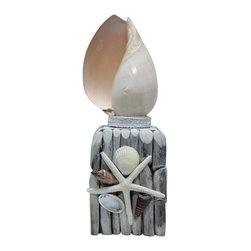 """Shell Night Light - The shell night light measures 4.5"""" x 4.5"""" x 13"""". The nightlight has a seashell at the top that's attached to a base made to look like a piling. It will add a definite nautical touch to whatever room it is placed in and is a must have for those who appreciate high quality nautical decor. It makes a great gift, impressive decoration and will be admired by all those who love the sea."""