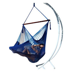 Jumbo Sized Royal Blue Weather Resistant Rope Hammock Chair - Hammock chairs bring style and relaxation to any decor. This Jumbo sized blue rope hammock chair is hand woven from soft spun polyester. Unlike cotton chairs, they will not rot, mold or mildew, and should last you for years. Woven into the body is an extra long extendable footrest that enables the user to really stretch out. The tropical hardwood spreader bar s a full 47 inches wide giving ample shoulder room for any sized person, and has multiple coats of marine varnish to protect it from the elements. It has a maximum capacity of 275 pounds. This chair hangs easily from one suspension point that is 7.5ft or higher. NOTE: It does not come with stand or mounting hardware.