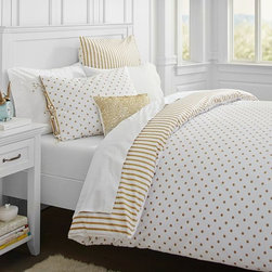 The Emily + Meritt Metallic Dottie Duvet Cover + Sham - I love this gold bedding for fall. It adds just a touch of sparkle and shine for the holiday season — or anytime.