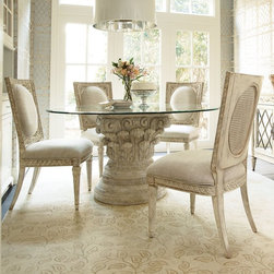 American Drew - Jessica McClintock The Boutique Collection 5 Piece Dining Table Set Multicolor - - Shop for Dining Sets from Hayneedle.com! Every brunch is elegant when eaten on the Jessica McClintock The Boutique Collection 5 Piece Dining Table Set. This set is rich in baroque beauty and includes a table and four chairs. The elegantly carved pedestal table base and chair frames are made of oak and pecan veneers. The table has a Pediment finish while the chairs are in White Veil. All finishes are heavily distressed for antique appeal. The round tempered clear glass top has a beveled edge. The chairs feature tapered ornately carved front legs flared back legs and rectangular seat backs. Padded seats and oval shield back rests are upholstered in neutral linen.About American DrewFounded in 1927 American Drew is a well-established leading manufacturer of medium- to upper-medium-priced bedroom dining room and occasional furniture. American Drew's product collections cover a broad variety of style categories including traditional transitional and contemporary. Their collections range from the legendary 18th-century traditional Cherry Grove celebrating its 42nd year of success to the extremely popular Bob Mackie Home Collection influenced by the world-renowned fashion designer Bob Mackie. Jessica McClintock Home features another beloved designer bringing unique style to an American Drew line. American Drew's headquarters are located in Greensboro N.C. Their products are distributed through thousands of independently owned retailers throughout the United States and Canada and around the world.