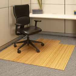 Natural 55 x 57 Bamboo Roll-Up Office Chair Mat - The Bamboo Roll-Up Office Chair Mat is an exotic and beautiful alternative to traditional office chair mats. Made in the remote Anji Mountains of China these striking mats are crafted from 100% Anji Mountain bamboo.Bamboo is a hardy fast-growing grass that is both versatile and ecologically friendly. The unique climate in the Anji Mountains makes Anji Mountain bamboo the strongest and most durable bamboo in the world and the finest flooring-grade bamboo on the market.The extraordinary material from which these mats are made is only part of what makes them exceptional. They also feature premium felt backing that cushions edges and protects floors seven layers of Klumpp UV finish for added durability and scratch-resistance and a unique design that is easily transported and requires no assembly.This Natural Bamboo Office Mat is ideal for smaller spaces. It features a natural golden color and rolls up for easy portability. This high-quality mat is not only practical but it also makes a unique and artistic accent piece in any office.Anji Mountain Bamboo Rug Company offers the finest quality selection and pricing of bamboo rugs on the market today. The manufacturers of these fine rugs work closely with designers to offer all of the latest styles. As the world begins to address serious environmental issues such as pollution and destruction of the rainforests society is rediscovering the natural wonder that is bamboo. Anji Mountain Bamboo Rugs are available in a wide variety of popular sizes and eye-catching patterns. They are attractive durable easy to clean and ecologically friendly.