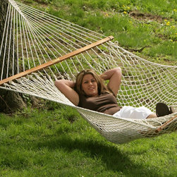 TwoTree Hammocks - Rope Hammock: Island Bay Northshore Large Rope Hammock - Shop for Hammocks from Hayneedle.com! The Island Bay Northshore Large Rope Hammock is a perfect introduction to the lifestyle of the relaxed and easygoing. Built for a single person this hammock shows what relaxation is all about. It features a dual weave for extra support and lasting durability. You can enjoy this hammock nearly anywhere because it measures only 11 feet from hanging ring to hanging ring with spreader bars measuring 4 feet wide. This polyester hammock use extra thick soft-spun 6mm rope cord. Oak wood spreader bars make getting in and out of this hammock easier and safer. They are finished with several layers of weather-resistant varnish to withstand the elements. Enjoy these features: FREE hanging hardware 6mm cord- thicker than many other models Dual weave for enhanced support and durability Woven with nearly 700 feet of twisted rope Oak spreader bars for safer easier access 2-year satisfaction guarantee to cover any defects About Island Bay Island Bay brings you well-designed authentic hammocks and accessories from around the world. From the East Coast to the West Indies the hammock is recognized as the ultimate getaway so we've dedicated ourselves to getting it right. You'll find eye-catching colors and patterns comfortable outdoor designs and heavy-duty stands designed to keep you swinging peacefully. It's your world ... relax in the real thing.