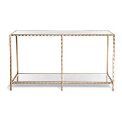Kathy Kuo Home - Modern Hollywood Regency Glamour Gold Studded Console - This piece has a certain type of luxurious rock and roll attitude.  Kind of like a Rick Owens jacket -  edgy, but something that feels especially good in Paris.  This console in antique gold has those small pyramid shaped studs usually found around the wrist of a punk rocker or Rottweiler. Luxurious, edgy and perfect.