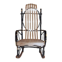 Chelsea Home Furniture - Chelsea Home Lyddie Rocker - Take some time out to relax your body in the Lyddie Rocker with red Oak back and seat with natural finish, and relax your mind knowing it is a handcrafted one-of-a-kind piece of art. All pieces of hickory are tightly put together with stainless screws for a great natural look both indoor and outdoor. Chelsea Home Furniture proudly offers handcrafted American made heirloom quality furniture, custom made for you. What makes heirloom quality furniture? It's knowing how to turn a house into a home. It's clean lines, ingenuity and impeccable construction derived from solid woods, not veneers or printed finishes over composites or wood products _ the best nature has to offer. It's creating memories. It's ensuring the furniture you buy today will still be the same 100 years from now! Every piece of furniture in our collection is built by expert furniture artisans with a standard of superiority that is unmatched by mass-produced composite materials imported from Asia or produced domestically. This rare standard is evident through our use of the finest materials available, such as locally grown hardwoods of many varieties, and pine, which make our products durable and long lasting. Many pieces are signed by the craftsman that produces them, as these artisans are proud of the work they do! These American made pieces are built with mastery, using mortise-and-tenon joints that have been used by woodworkers for thousands of years. In addition, our craftsmen use tongue-in-groove construction, and screws instead of nails during assembly and dovetailing _both painstaking techniques that are hard to come by in today's marketplace. And with a wide array of stains available, you can create an original piece of furniture that not only matches your living space, but your personality. So adorn your home with a piece of furniture that will be future history, an investment that will last a lifetime.