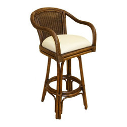 Hospitality Rattan - Indoor Swivel Rattan & Wicker 30 in. Bar Stool (Beach House) - Fabric: Beach House. Key West charms are obvious influences that have timeless appeal. Our classic barstool with a swivel base features cane structuring accented with twisted cane fiber arms and a basket weave back inset. Choose fabrics to complete your personal beach retreat. Made of Rattan Poles & Woven Wicker. Finished in Antique Color. Includes cushion with choice of fabric in a variety of colors and patterns. 360 Degree Swivel Mechanism included. Constructed of commercial quality rattan poles. Requires Some Assembly (Instructions Included). Arm Height: 38 in.. Overall: 23 in. L x 23 in. W x 43 in. H (25 lbs.)A traditional wicker and rattan swivel barstool that is built with solid rattan pole construction reinforced with a pencil rattan twist. The Key West Collection offers three basic finishes. The barstools and counter stools feature commercial grade reinforced rattan bases, swivel mechanisms & reinforced double pole footrests. In addition your choice of over 31 fabrics is available on the Key West Collection. Some Assembly Required.