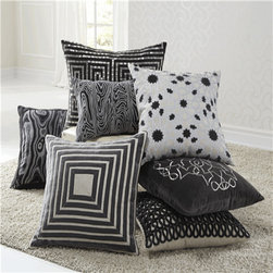 Trends for 2014 - For 2014, black & white will take on a softer look with all-white furniture & walls adding bold throw pillows on your sofa or bed.