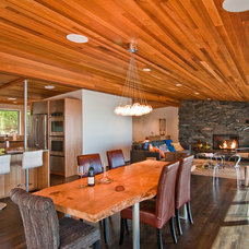 Midcentury Dining Room by BUILD LLC