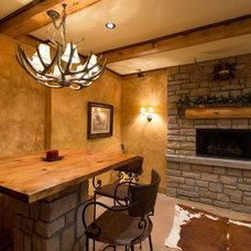 Rustic Basement by Michaelson Homes LLC