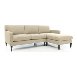 Rochelle 2-Piece Sectional Sofa - Soft, subtly textured fabric beautifully tailors Rochelle's timeless mid-century lines. Crisp self-welting outlines Rochelle's slim frame and track arms that open up to plush cushioned seating. Tapered hardwood legs enhance the modern, elegant look.