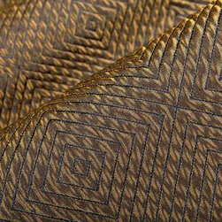Impulse Geometric Upholstery Fabric in Bronze - Impulse Geometric Upholstery Fabric in Bronze has a brown diamond pattern with a slight sheen that gives a metallic look. Ideal for upholstering sofas, chairs, and ottomans or for creating custom bedding and pillows. Made in the USA from a blend of 18% cotton, 32% olefin, and 50% polyester. This upholstery fabric passes 30,000+ double rubs on the Wyzenbeek Abrasion Test. Passes CA117 Test, UFAC 1 Width 53″; Repeat: 5 3/4″ H; 5″V