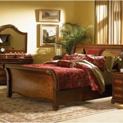 Classico Sleigh Storage Bed - Exotic elegance combines with function in the Classico Sleigh Storage Bed. This beautifully crafted bed features a traditional design embellished with gorgeous grape vine moldings on the headboard and nailhead trim around the edges. For those in need of storage, spacious drawers are available, offering an abundance of room for blankets, linens, and other bedroom items. Constructed of poplar solids with ash and cherry veneers then completed with a warm cherry finish.About aspenhomeOver the past 30+ years, aspenhome™ has transformed from a small, family owned entertainment business in Phoenix to a full-line furniture company specializing in thoughtful, innovative products designed for the way people work, play, and relax at home. Aspenhome™ has received a number of recognitions including: 6 Pinnacle Design awards, Consumer's Digest Best Buy for home entertainment, Home Furnishing's News Award of Excellence for entertainment, and Furniture Today's 2008 Supplier of the Year. Aspenhome™ is a proud sponsor of City of Hope, dedicated to the research, treatment, education, prevention, and cure of cancer and other life-threatening diseases.