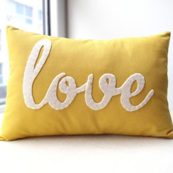 Yellow Love PIllow by Honey Pie Design - This pillow says it all — and in a sunny yellow color to boot.