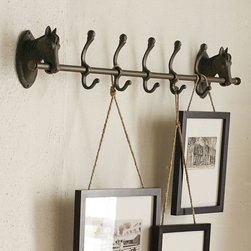 Horse Row of Hooks - This is a great way to hang picture frames and add interest at the same time.