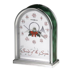 Howard Miller - Howard Miller Sounds of the Season Musical Table Top Clock - Howard Miller - Mantel / Table Clocks - 645687 - Further the Christmas spirit in your living area with the Sounds of the Season Table Clock. Distinguished by its illustrated bow dial and featuring a different carol tune at each hour this charming accent clock is sure to be a favorite every holiday season. Quartz movement operation ensures reliable timekeeping to round out the appeal of the Sounds of the Season clock.