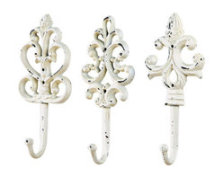 White Iron Hooks - Shabby iron hooks to hang aprons and tea towels add some more charm to the room.