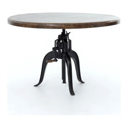 Four Hands - Rockwell Adjustable Round Dining Table - Vintage machine parts are salvaged, refurbished and given new life in this dazzling and versatile table. The crank raises and lowers the top, allowing you to adjust it for meals, games or decorative use. The top is fashioned from sustainably harvested mango wood, providing a warm, natural counterpoint to the antiqued metal base.