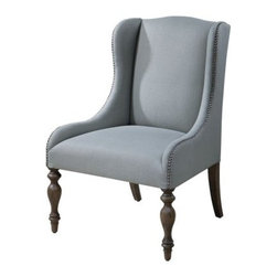 Uttermost Filon Wing Chair - Misty Seaglass - A beautiful addition to any space, the Uttermost Filon Wing Chair - Misty Seaglass brings an air of class to your modern decor. Its solid hardwood construction features a traditional wing style and is upholstered in a soft fabric that showcases a lovely misty sea glass hue. Silver accenting nails emphasize the slim, sloping arms, and wooden turned legs that display a soft, sunwashed pine finish. Sit comfortably and in-style within living, office, and bedroom decors.About UttermostThe mission of the Uttermost Company is simple: to make great home accessories at reasonable prices. This has been their objective since founding their family-owned business over 30 years ago. Uttermost manufactures mirrors, art, metal wall art, lamps, accessories, clocks, and lighting fixtures in its Rocky Mount, Virginia, factories. They provide quality furnishings throughout the world from their state-of-the-art distribution center located on the West Coast of the United States.