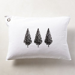 Anthropologie - Three Trees Pillow - The trio of trees on this otherwise blank canvas makes for a subtle touch when incorporating a camping or forest theme.