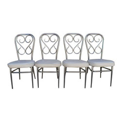 """Pre-owned 1960s Chrome Ice Cream Parlor Chairs - Set of 4 - I scream, you scream, we all scream for 1960s bentwood chrome ice cream parlor chairs! These are rare and beautiful, with heavy chrome frames and creamy white faux-leather upholstery. This set of four will add vintage charm to your dining table or breakfast nook.    Seat height: 17"""""""