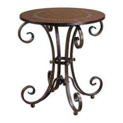 Uttermost - Lyra Round Accent Table - Stately scrollwork and rustic accents make this accent table a perfect blend of masculine and feminine style. The hand-forged metal base boasts a regal, antique bronze finish, and a delicately scrolling design, and the round top provides grounding with its studded, faux leather surface. This masterfully crafted table would work amazingly well either indoors or on the back deck.