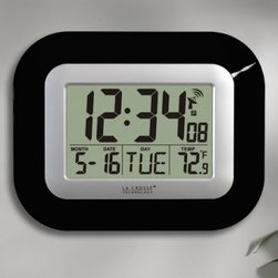 La Crosse Technology WT-8005U - 9 in. Digital Atomic Wall Clock - The La Crosse Technology WT-8005U - 9 in. Digital Atomic Wall Clock is a small wall clock that makes a big impression. The large high-contrast display is easily seen from across a room. Hang this clock on a wall or stand it on a desktop for convenient time date day and indoor temperature information from 14.1 to 139.8 degrees F (-9.9 to 59.9 degrees C). Atomic clocks work so accurately because they synchronize with the master clock at the U.S. Naval Observatory the official source of time for the U.S. Department of Defense. This contemporary wall clock automatically updates to daylight-saving time and features U.S. time zone selection for Eastern Central Mountain and Pacific time. Easy to set up accurate and reliable this timepiece comes in your choice of three colors: black white or silver. Measures 9W x 1D x 7.25H inches. Requires two AA batteries (not included). Expect battery life of up to 24 months. Includes instructions. About La Crosse TechnologyFounded in 1985 La Crosse Technology was the first company to introduce atomic timepieces to the consumer market. This multinational company sticks to its original small-town philosophy of providing customers with the highest level of service. Among their available products are radio-controlled timepieces wireless weather stations and other measuring devices. All La Crosse weather instruments clocks and watches are calibrated daily to the atomic time standard of the NIST.