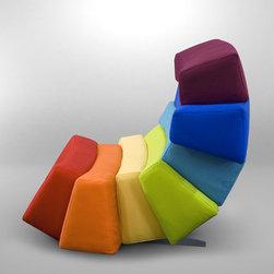 Iris Design Sofa - This is undeniably pricey, but it's too perfect. The Iris collection by Dizajno is inspired by light and color, and this sofa would be a gorgeous addition to a rainbow-themed room.