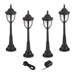 """Super Duty - Traditional Super Duty Casa Sierra 6-Piece Black LED Landscape Light Set - Add access lighting to your outdoor spaces with this complete landscape lighting set from the Casa Sierra collection by Super Duty™. Four low voltage and energy efficient LED landscape lights with clear seedy glass a frosted glass diffuser and a black finish provide illumination.. A 45-watt low voltage transformer is included which features a built-in photocell for dusk to dawn operation. A black landscape wire completes the kit so you can connect your lights bringing this set together for a spectacular look. Works with existing low voltage landscape lighting systems.  6-piece set finish in black.  Cast aluminum construction.  4 LED landscape lights 45-watt low voltage transformer cable.  Part of the Super Duty™ line.  Landscape lights include integrated 3 watt LED module.  Comparable to a 25 watt incandescent bulb.  Free 45 watt transformer.  Full ON mode or 3 AUTO settings (4 6 and 8 hours).  Built in photo-cell for dusk to dawn operation.  Free 50 feet of cable.  Includes 9 1/2"""" ground stakes.  Lights are 30 1/2"""" high 7 1/2"""" wide."""