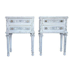 Italian Renassiance End Tables - A pair of Italian Renaissance end tables with fluted legs, two drawers, and a beautiful intricate carved design throughout. They are finished in cream with gray antique glaze. Original paint does show normal vintage wear, with patina on top of tables. The tables are naturally distressed.