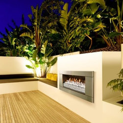 Escea Ferro Stainless Steel Outdoor Gas Fireplace Insert - The contemporary appeal of the Escea Ferro Stainless Steel Outdoor Gas Fireplace Insert makes any outdoor entertainment area the perfect place to enjoy friends and family. This fireplace insert looks great with a stainless steel finish, your choice of flame bed, and a modern design that elevates any setting. It offers up to 56,000 BTUs of heating power yet requires no venting. It can be installed straight into any timber framed external construction, suitable wall, or masonry cavity. Use liquid propane or natural gas for fuel. Note: Review any building restrictions or construction permit requirements before installation of an outdoor fireplace. Contact your local zoning commission/homeowners association for details. Contact a licensed contractor for installation as this product may require connection to a natural gas line.About EsceaEscea was founded in 2002 in New Zealand on the idea that the home fireplace should not only be functional but remarkably beautiful as well. Since their beginning the company has become a leader in the industry, designing, manufacturing, and distributing quality gas burners and outdoor fireplaces. Escea's success has given them a world-wide clientele and has garnered them multiple awards recognizing their talents and product designs.