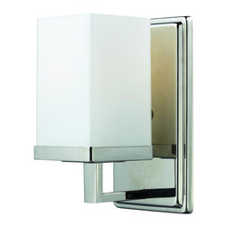 One Light Chrome Matte Opal Glass Bathroom Sconce - A rectangular matte opal shade complimented with a chrome geometric inspired wall mount allows for this fixture to as modern as it in compact. This fixture would be perfect as a vanity fixture, or for adding a touch of modern flair around the house.