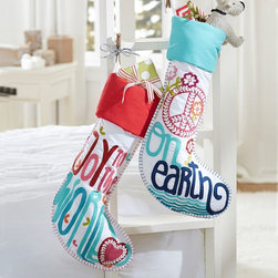 Embroidered Stockings - My daughter would love to have these stockings for the holidays. I would use them in her bedroom to add some fun holiday decor to her personal space.
