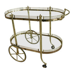Pre-owned Vintage Regency Brass & Glass Server - A two-tier Italian Regency style brass and glass rolling bar cart server or trolley. Fill this cart with bottles and barware worth displaying and let it become the life of the party!