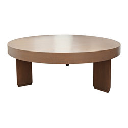 James Huniford - Consigned Huniford 3 Legged Coffee Table - Designer James Huniford puts the emphasis on shape in his three legged coffee table. Here, the solid legs beautifully balance the round top. The simple form also puts the spotlight on the rich color of the oak veneer.