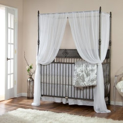 Bratt Decor Wrought Iron Indigo 2 in 1 Convertible Crib Collection - Pewter - Add an elegant touch to any nursery with the Bratt Decor Wrought Iron Indigo 2 in 1 Convertible Crib Collection – Pewter. This crib collection is made of durable embellished wrought iron for a distinctive look that's built to last. Its sophisticated style doesn't skimp on functionality as it provides a comfy place for your baby to rest while offering a handy matching changer for mom and dad. Its four-post design adds a way to provide a helpful and beautiful canopy. When your child gets older this crib easily converts to a full-size canopy bed when you add the conversion kit (not included). The changer fits standard 32 x 16 changing mats. About Bratt DecorBratt Decor was born out of necessity after Mary and Stephen Bauer's long trying and unsuccessful journey to find the perfect crib. The couple sought a crib that would bring beauty harmony sophistication and balance to their nursery. They wanted sumptuous luxurious and comfortable. And they wanted the nursery to feel like home. After scouring every store in two major U.S cities the couple was disappointed in the selections. Nothing fit their vision and those that came close were beyond their budget. That's when the Bauer's took matters into their own hands and built their own crib. They realized there must be other discouraged parents out there disappointed in the cribs available. That's when Bauer's set out to start their own business to make the world's most beautiful cribs at prices normal people could afford.