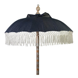 "Seaside Denim Umbrella - Our Seaside Denim umbrellas come with a natural off white, hand knotted fringe trim. The wood is a bit lighter than our other umbrellas and has silver leaf on the carved parts.Dimensions: Diameter 70"" H. 100"""