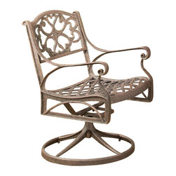 Home Styles - Home Styles Outdoor Swivel Dining Arm Chair in Rust Brown Finish - Home Styles - Patio Dining Chairs - 555553 - The Home Styles Outdoor Swivel Dining Arm Chair is constructed of solid cast aluminum with a hand antiqued powder coat rust brown finish. This arm chair has rocking and swivel features and intricate metal work designs. Distinctly traditional in style the Home Styles Outdoor Swivel Dining Arm Chair offers a lasting appeal you will enjoy for many years.Features:
