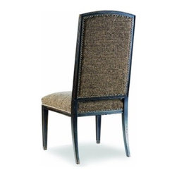 Mirage Dining Side Chairs - Set of 2 - A one-two punch, the Mirage Dining Side Chairs - Set of 2 will knock out boring design. The classically shaped frame is finished in ebony for an updated look that is both streamlined and elegant. A thick, muted tweed upholstery provides the perfect contrast and provides ultimate comfort and durable style. Harwood construction means this set is not just pleasing to the eye, but solid, sturdy and long-lasting as well.The true quality of these chairs becomes evident in their supreme attention to detail. Like fine jewelry, nail head trim finishes the look, and both the front and back of the chair are upholstered for consistency. The timeless look of these dining room chairs makes it easy to fit them into any modern home. So take off the gloves, and show the world you're a design heavyweight.Not available for sale in, or delivery to, the state of California.About Hooker Furniture CorporationFor 83 years, Hooker Furniture Corporation has produced high-quality, innovative home furnishings that seamlessly combine function and elegance. Today, Hooker is one of the nation's premier manufacturers and importers of furniture and seeks to enrich the lives of customers with beautiful, trouble-free home furnishings. The Martinsville, Virginia, based company specializes in lifestyle driven furnishings like entertainment centers, home office furniture, accent tables, and chairs.Construction of Hooker FurnitureHooker Furniture chooses solid woods and select wood veneers over wood frames to construct their high-quality pieces. By using wood veneer, pieces can be given a decorative look that can't be achieved with the use of solid wood alone. The veneers add beautiful accents of color and design to the pieces, and are placed over engineered wood product for strength. All Hooker wood veneers are made from renewable resources and are located primarily on the flat surfaces of the furniture, such as the case tops and sides.Each Hooker furniture piece is finished using up to 30 different steps, including 13 steps of hand-sanding and accenting. Physical distressing is done by hand. Pieces receive two to three coats of solid lacquer to create extra depth and add durability to the finish. Each case frame is assembled using strong mortise-and-tenon joints, which are then reinforced by mechanical fasteners and glue. On most designs, end panels extend to the floor to add strength and stability. Panel-style furniture features strong panel and frame construction to help avoid warping.Your Hooker furniture features finished case interiors to eliminate unsightly raw wood and to help protect items you may store inside drawers or cabinets. Drawer parts are given a urethane or lacquer finish to create smooth action and durability. All drawers use dovetails, either English or French, for years of problem-free use. Drawer bottoms are constructed from plywood and attached to the plywood drawer sides via the use of hot glue and/or wood glue blocks. Most drawers are full width, depth, and height to provide the maximum amount of storage space.